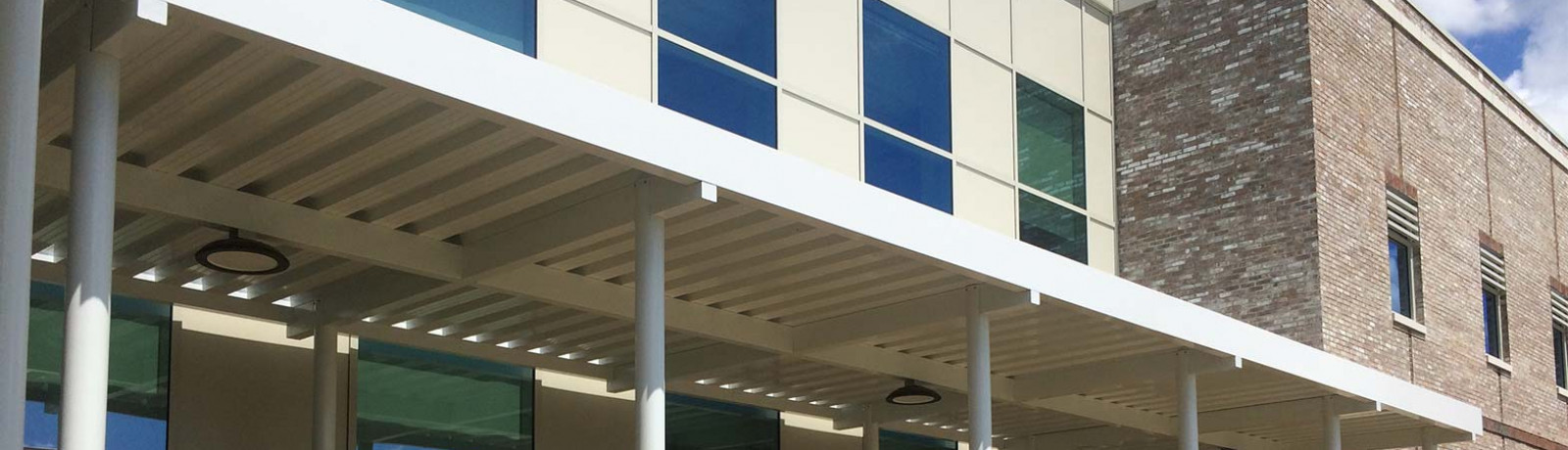 An example of an Aluminum walkway cover from Tennessee Valley Metals.