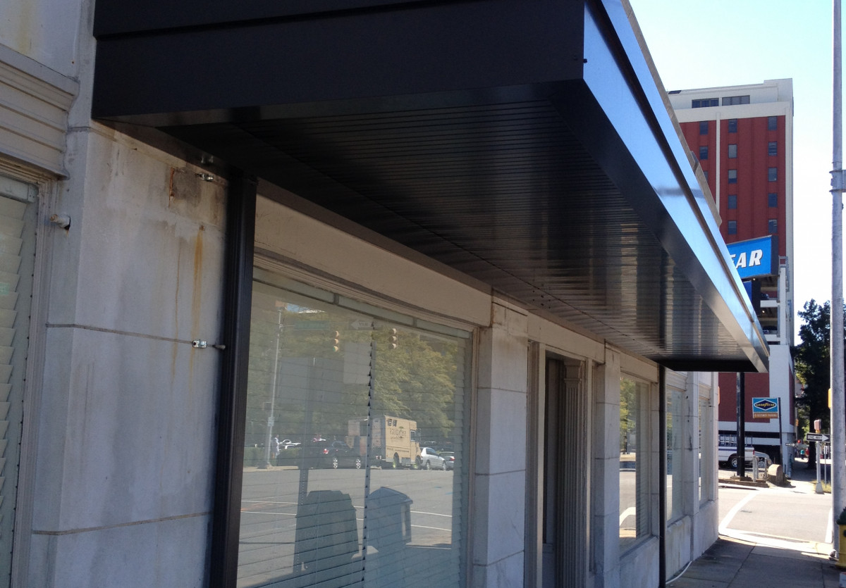 An aluminum canopy over a storefront.