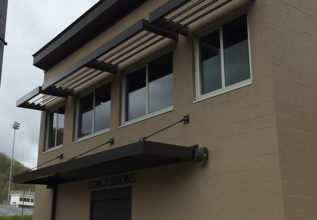 Black aluminum sunshades made by Tennessee Valley Metals on the side of a building.