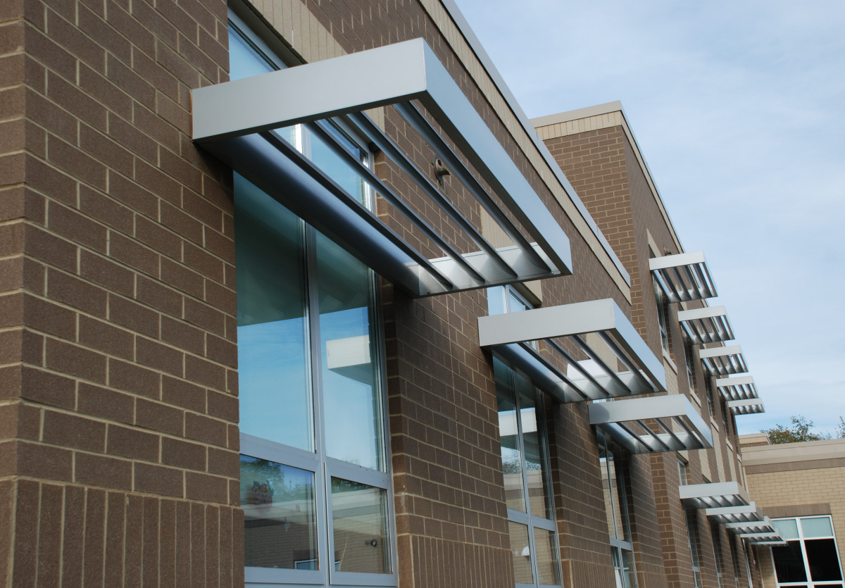 Silver, aluminum sunshades made by Tennesee Valley Metals on a building.