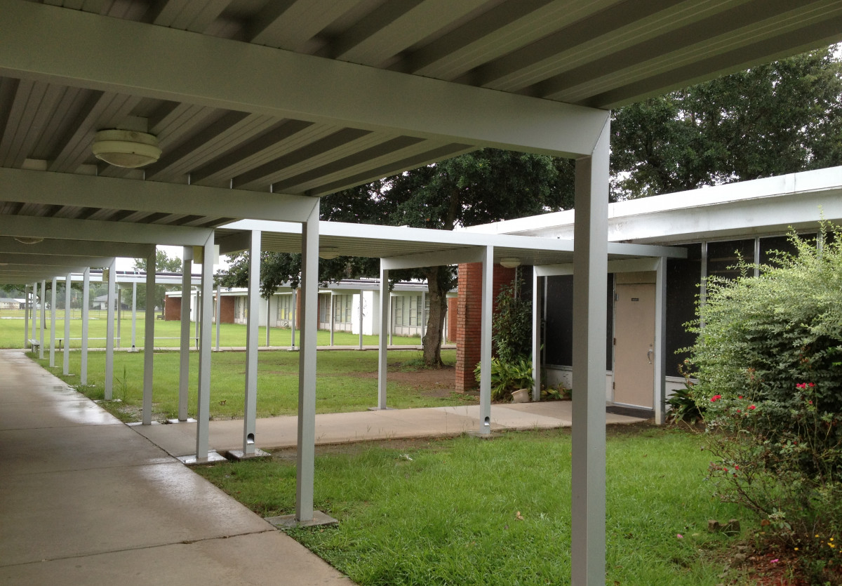 Custom aluminum walkway covers at a school.