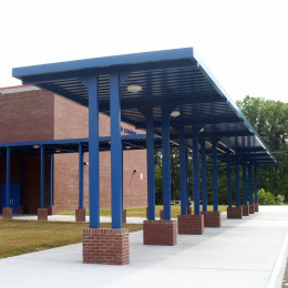 Custom, blue aluminum walkway covers at a school.