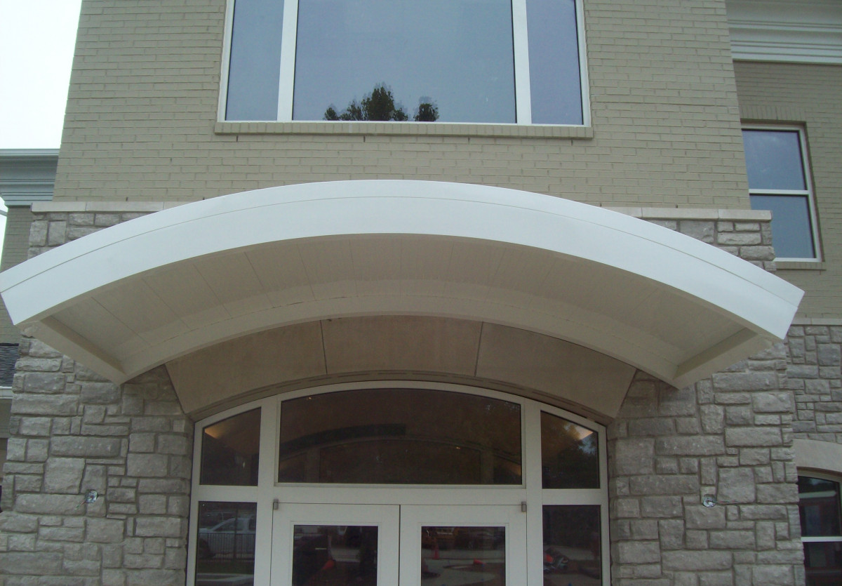 A white, custom made aluminum canopy made by Tennessee Valley Metals for Hickory Valley Fitness.