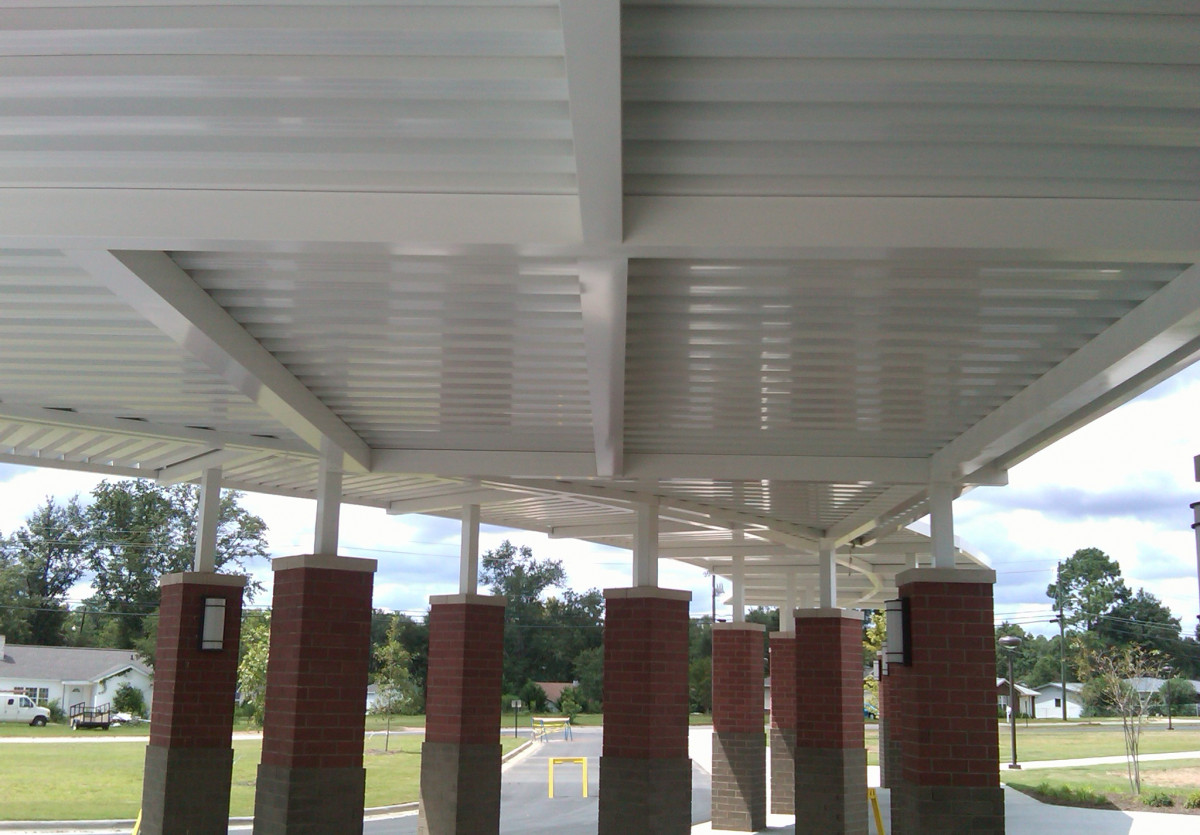 The underside of a custom aluminum walkway cover system.