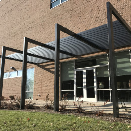 Black, custom made aluminum sunshade made for Vol State Community College by Tennessee Valley Metals.