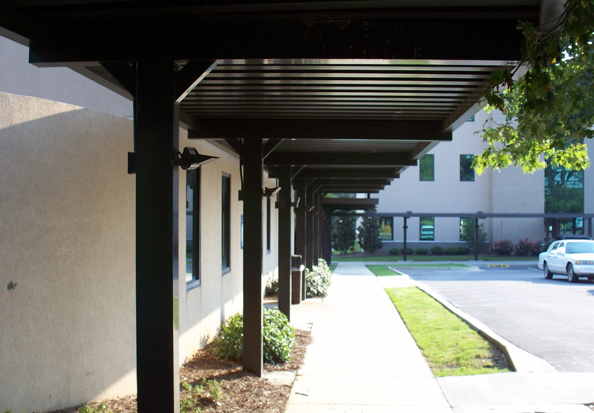 Custom aluminum walkway covers outside of a hospital.
