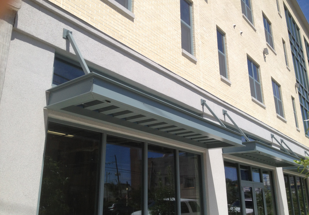 Custom aluminum canopies made for the CGHP-MLK Building in New Orleans, Louisiana.