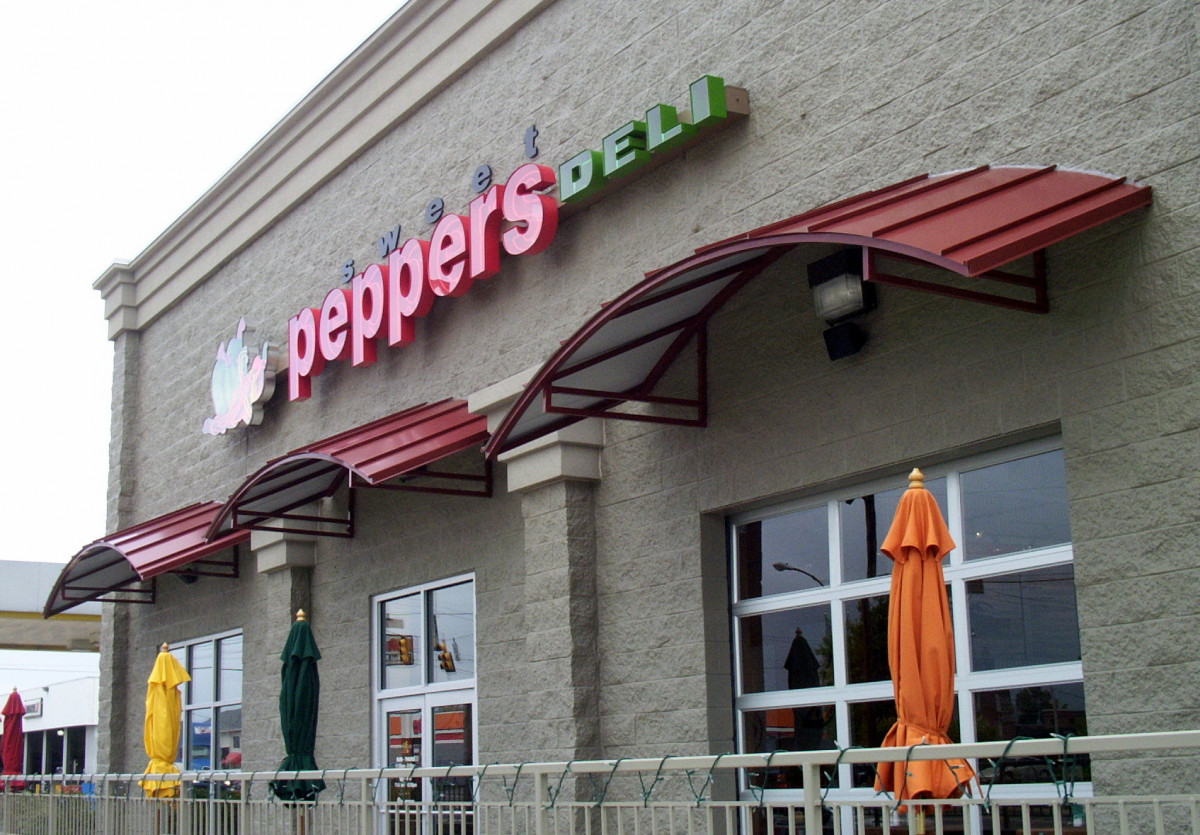 Custom-made aluminum awnings made for Peppers Deli by Tennessee Valley Metals.