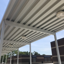 Custom made aluminum walkway cover outside of a school.