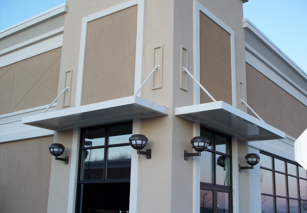 An example of a custom made, white aluminum sunshade for the Turkey Creek Shopping Center in Knoxville, Tennessee.